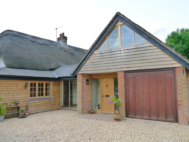 Large extension to a thatched cottage